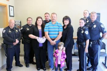 Faith House Trisha Jones (third from left) and Cindy Triche (fifth from left) presented the Abbeville Police Department with Hershey's Kisses. Representing the APD are (L to R) Joey Boneski, John Castille, Leland Laseter, Chief Tony Hardy, Sammie Bodin, Kale Dehart and Chris Hardy.