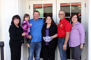 "Faith House's Cindy Triche (far left) and Trisha Jones (middle) present Vermilion Parish Sheriff Mike Couvillon, Col. Kirk Frith and Vermilion Parish Clerk of Court Diane Meaux Broussard with ""Kisses for Cops."""